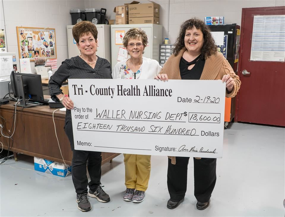 Photo of Waller ISD Health Services Department receiving grant