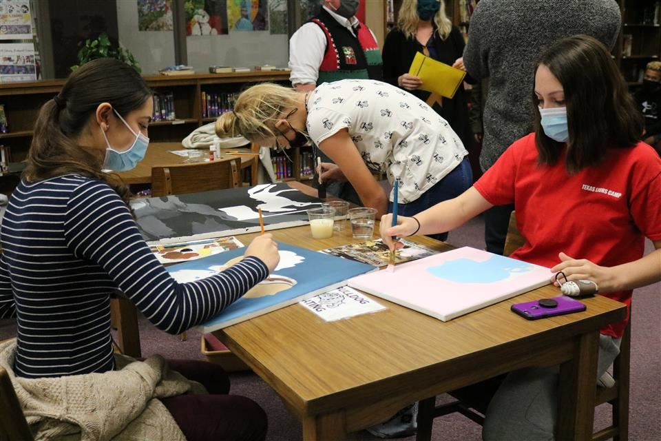 Photo of students working on art design